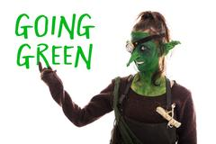 Green goblin pointed of text going green, sustainable development, isolated Stock Photos