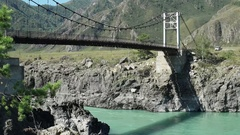 Automobile bridge over Katun river in Altay, Russia. Stock Footage