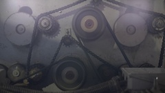 Timber mill. View of gears and chain rotate Stock Footage
