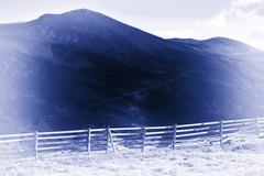Norway fence in mountains blue sepia background Stock Photos