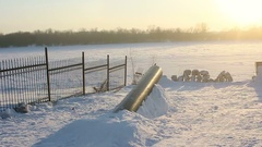 Man on snowskate slides on the pipe Stock Footage
