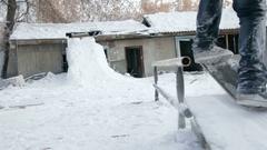 Man on snowskate slide on the rail Stock Footage