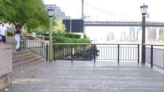 Couple running together on Roosevelt island Stock Footage