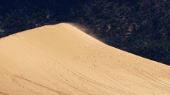 Sand blowing off the top of a dune at Coral Pink Sand Dunes Stock Footage