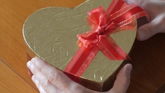 Putting Xmas gift in a heart shape box Stock Footage