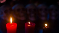 Skulls candles crypt burial site Stock Footage