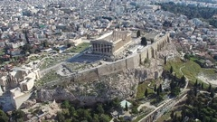 Aerial flying around Acropolis of Athens ancient citadel on rocky outcrop 4k Stock Footage