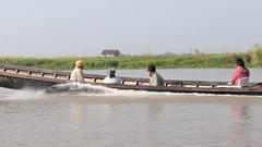 Boat with people crossing the inle lake water . Myanmar, Burma Stock Footage