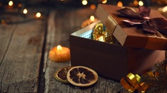 Christmas and New Year brown gift box with a shining bauble inside Stock Footage