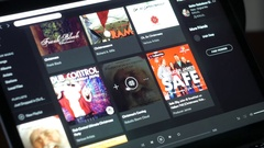 Listening to Christmas music in Spotify app Stock Footage