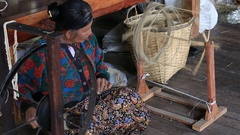 Women work  in textile manufacture in craft village . Inle Lake, Myanmar. Burma Stock Footage