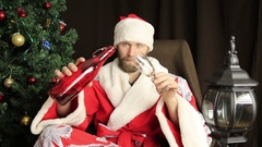 Bad brutal Santa Claus drink wine and says congratulations on the holiday, on Stock Footage
