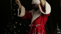 Bad brutal Santa Claus smiling and funny dancing, on the background of Christmas Stock Footage