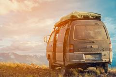 Offroad car concept with mountains. Microbus. Post-apocalyptic view Stock Photos