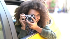 Cheerful girl taking pictures from a yellow cab, New York City Stock Footage
