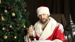 Bad brutal Santa Claus discontentedly reads letter with the wishes, on the Stock Footage