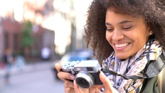 Trendy girl in New York City taking pictures with camera Stock Footage