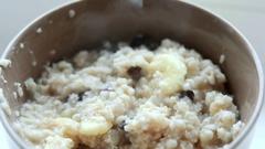 Chef fail. Hair in the porridge Stock Footage