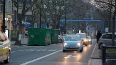 Cars drive on Kudam street, evening time, Berlin, Germany Stock Footage