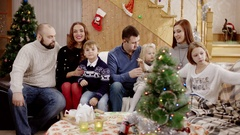 Happy familes waving at christmas party indoor Stock Footage