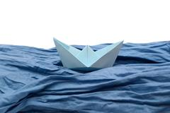 Blue paper boat, origami boats on white. Stock Photos