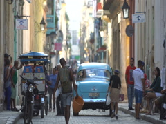 View to central street of Havana in sunny summer day. Old retro car is riding Stock Footage