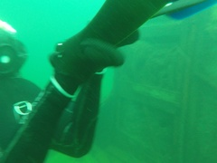 Pan to Scuba Diver with special light weight fins Stock Footage