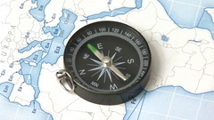 Compass on the world map searching the north Stock Footage