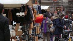 Woman shops and sells at flea market, Berlin, Germany Stock Footage