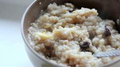 Porridge with banana and raisins Stock Footage