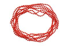Red beads border isolated. Christmas background. Stock Photos
