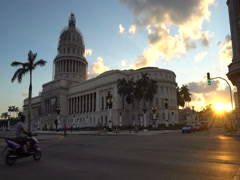 Old rare retro cars and bicycle taxi are moving near the ancient colonial Stock Footage