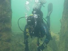 Scuba Diver near underwater structure Stock Footage