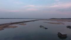 Drone shot: Bamboo bridge over the Mekong river before nightfall Stock Footage