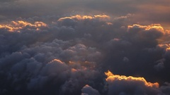 View through aircraft window on cloudscape at sunrise hours. 4k Ultra HD Stock Footage