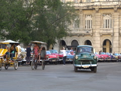 Retro cars, local autos, bicycle taxi and vehicles are riding near the central Stock Footage
