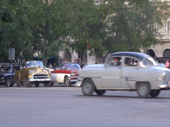 Retro cars, local autos, bicycle, horse taxi and vehicles are riding near the Stock Footage