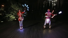 LED show performance in glowing costume at night Stock Footage