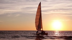 Yacht  approaching the shore at sunset. Stock Footage