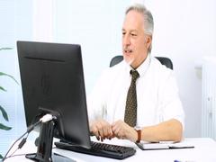 Man using his desktop computer Stock Footage