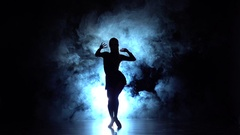Girl is dancing in smoke latin dance. Slow motion Stock Footage