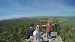 Group of young men at the top of the mountain Stock Footage