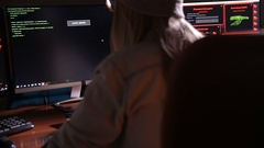 Female computer programmer coding, hacking in dark room Stock Footage