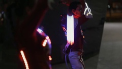 Neon show performance in glowing suit at night outdoor Stock Footage