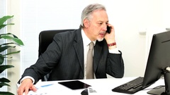Businessman getting angry while talking at the phone Stock Footage