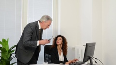Angry boss screaming to an employee Stock Footage