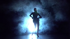 Young girl professionally dancing salsa in the haze. Slow motion Arkistovideo