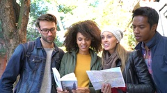 Friends visiting New York reading map and city guide Stock Footage