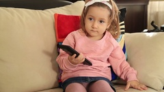 Little girl watching television 2 Stock Footage