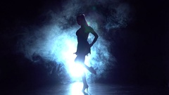 Woman dancing ballroom in the studio, silhouette. Slow motion Stock Footage
